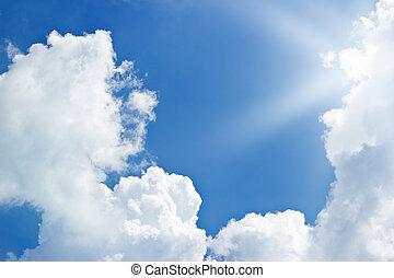 blue sky clouds and sunbeam