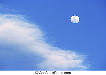 Blue sky, clouds and the moon
