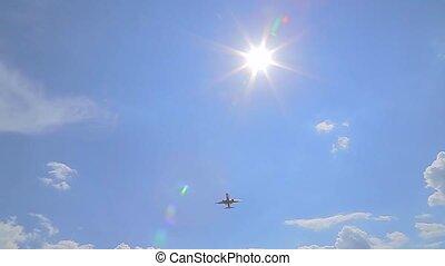 the plane flies through the sun