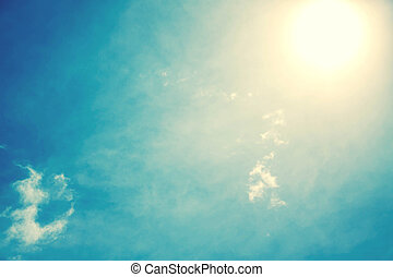 Blue sky cloudy in daylight and the sun