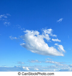 Blue sky image with with group of clouds in the middle