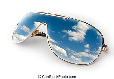 Blue sky in sunglasses
