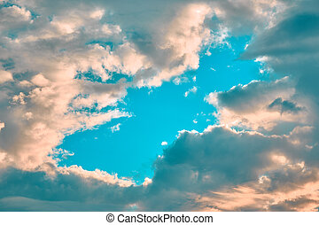 Blue sky in the center with clouds at the edges