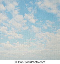 Blue sky on paper background