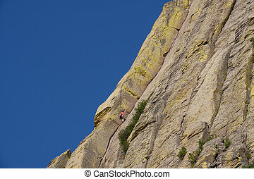 Blue Sky Over Climber on Devils Tower