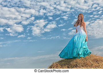 blue sky - Romantic young woman posing outdoor.