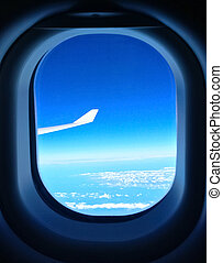 Blue sky seen from the airplane window
