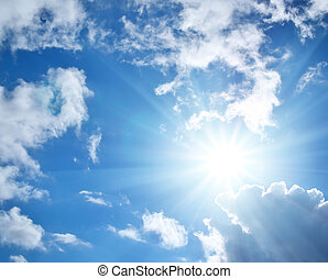 Blue sky with clouds and sun. Nature composition.