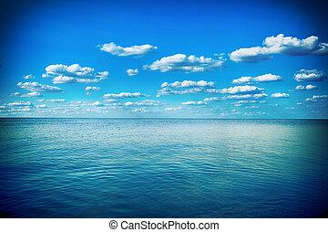 Blue sky, sun and sea