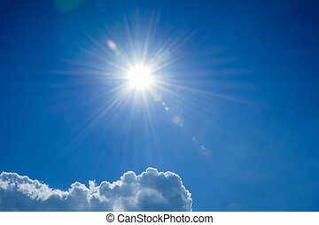 blue sky  sun rays  with light clouds
