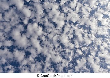 blue sky texture with fine white ragged clouds