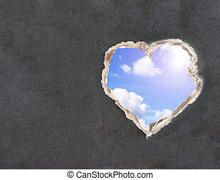 Blue sky with clouds and bright sun in a hole paper
