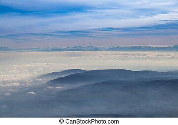 Blue sky with clouds and mountains background, aerial photography