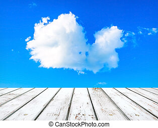 Blue sky with clouds and wooden plank