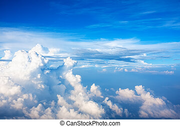 Blue sky with clouds, as background