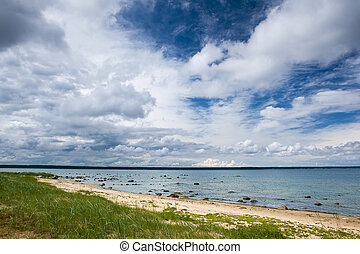 Blue sky with clouds at the sea