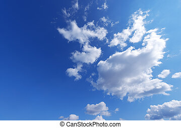 Blue and light blue sky with white clouds on the right, horizontal