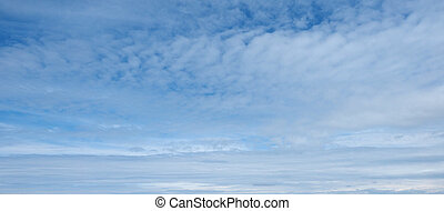 Blue sky with clouds useful as a background