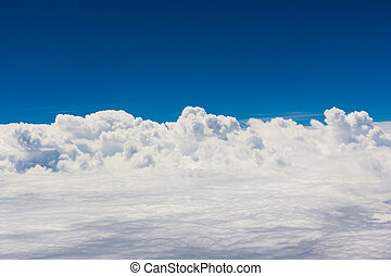 Blue sky with clouds background on the airplan