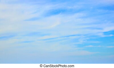 Blue sky with clouds - Blue sky and fast white clouds -...