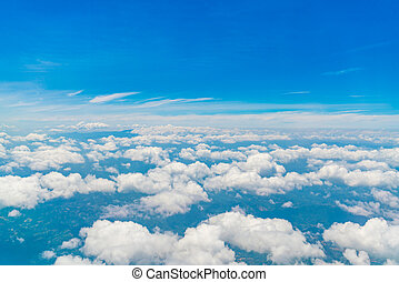 Blue sky with clouds .