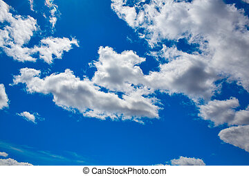 Blue sky with clouds in a summer day