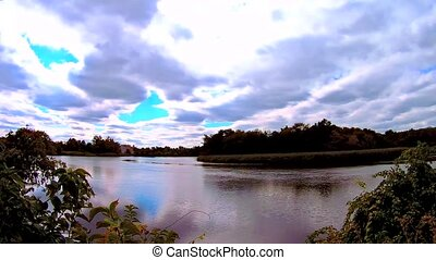 blue sky with clouds, lake. Real time lake sky clouds