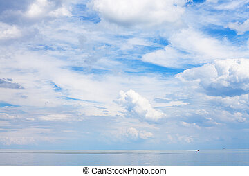 blue sky with clouds over calm water Sea of Azov