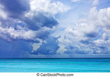 Blue sky with clouds over caribbean sea.
