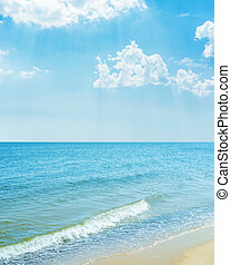blue sky with clouds over sea and sand beach
