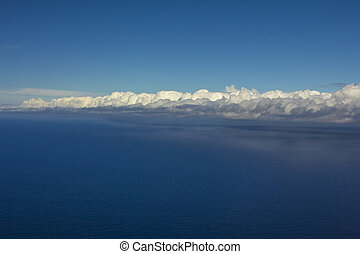 Blue sky with clouds over sea. Nature composition.