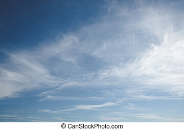 Blue sky with soft white clouds