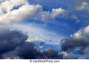 Blue sky with sunlight and storm clouds
