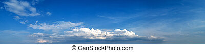Blue sky with tiny clouds. Panorama