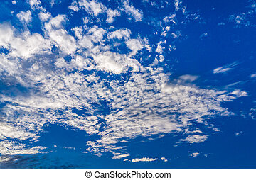 Blue sky with white clouds background.
