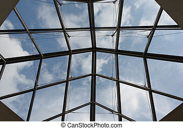 Blue sky with white clouds seen through windows