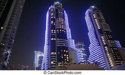 Blue skyscrapers of Dubai at night.
