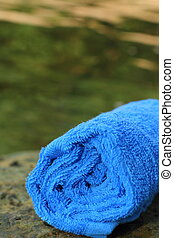 Blue spa towels on rock