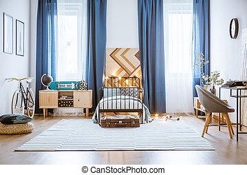Blue spacious bedroom interior