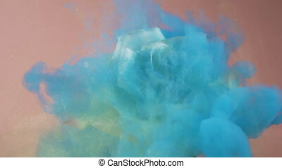 Blue sparkling cloud of acrylic paint covering blooming white rose