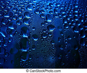 Blue sparkling drops as a background