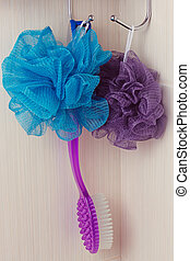 blue sponge hanging on a hook