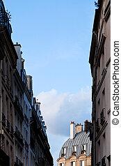blue spring sky between houses