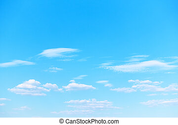 Blue spring sky with white light clouds