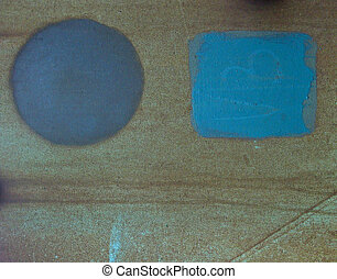 blue square and circle paint on grunge rusty metal