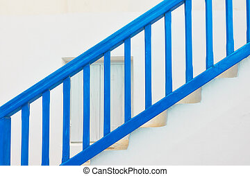 Blue staircase with wooden railing