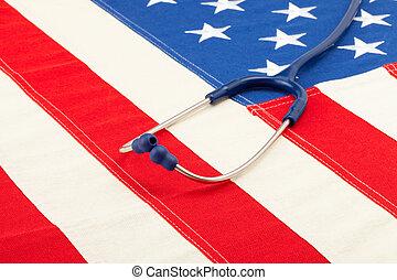 Blue stethoscope over US flag - studio shoot