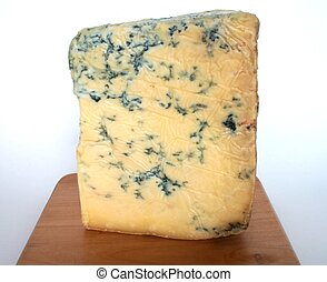 Blue stilton - A wedge of blue stilton on a wooden cheese...