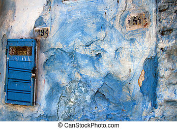 Blue street wall with house number