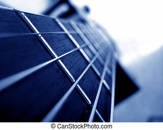 Blue Strings - A background of a accoustic guitar in blue...